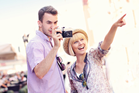 A picture of a young couple taking pictures on a tour around Gdansk in Poland photo