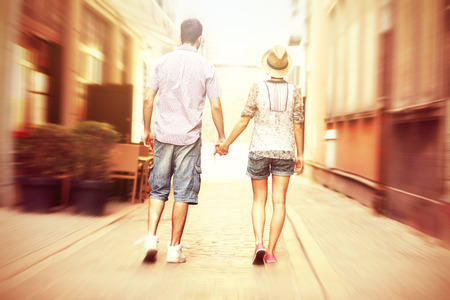 strolling: A picture of the back of a young couple strolling about the city Stock Photo