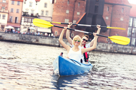 gdansk: A picture of a young couple in a canoe sigtseeing Gdansk in Poland