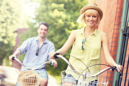 A picture of a young couple cycling in the city photo