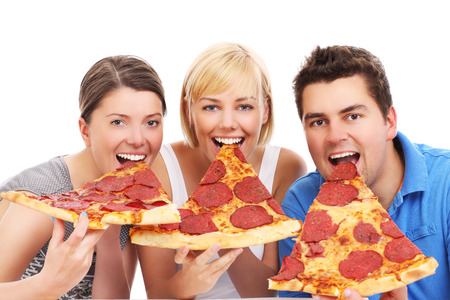 over eating: A picture of a group of friends eating big pizza slices over white background