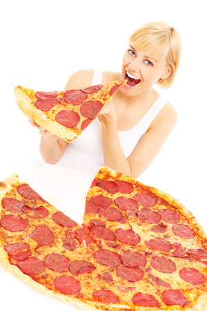 A picture of a woman eating pizza over white background photo
