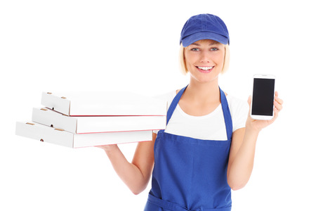 A picture of a happy woman with pizza boxes and cellphone over white background photo