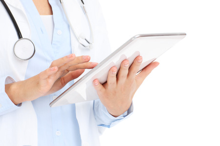 A picture of a doctor holding tablet over white background photo