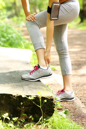 beautiful ankles: A picture of a jogger having problems with ankle in the forest