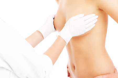 A midsection of a doctor examining breast