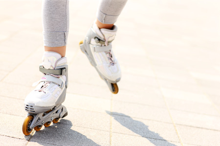 roller blade: A picture of womans legs with roller blades on the path Stock Photo
