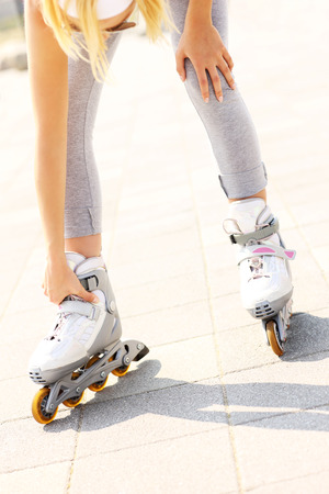 blading: A picture of a woman having problem with ankle while roller blading