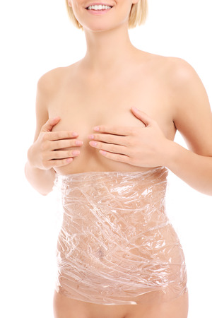 naked belly: A picture of womans body wrapped in foil over white background
