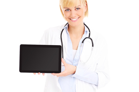 A picture of a young doctor standing with tablet over white background photo