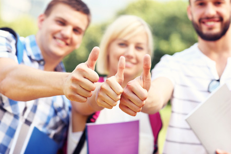 ok hand: A picture of a group of students showing ok signs in the park Stock Photo