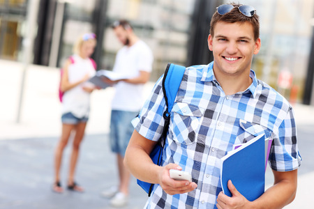 A picture of a student using smartphone in the campus Stock Photo