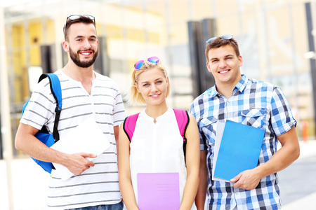 A picture of a group of students standing in the college campus photo