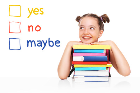 girl sit: A school girl trying to make a decision over white background