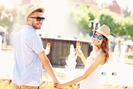 gelato: A picture of a romantic couple eating ice-cream in the park