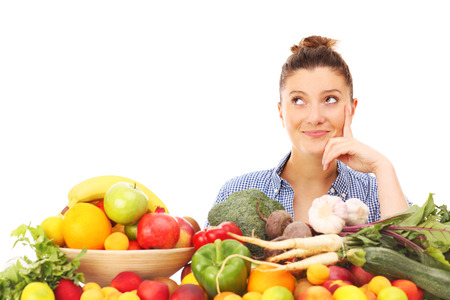 A picture of a happy woman with fruits and vegetables over white background photo