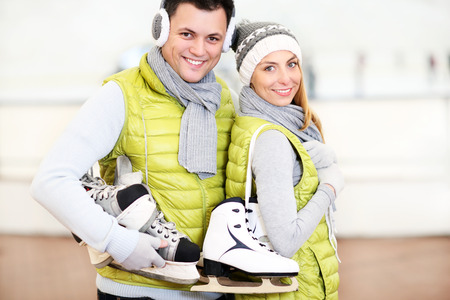 ice rink: A picture of a happy couple in the ice rink Stock Photo