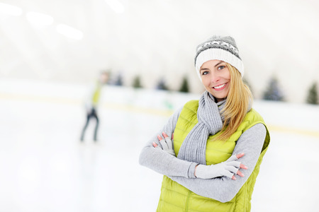 A picture of a happy woman on the ice rink photo