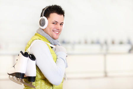 ice rink: A picture of a happy man on the ice rink Stock Photo