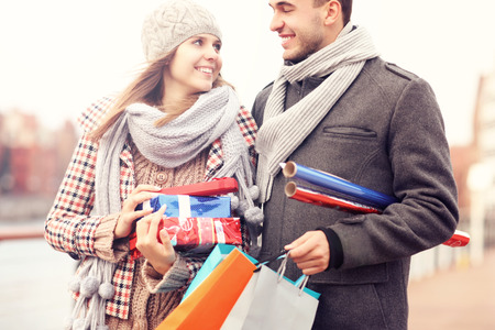 christmas shopping bag: A picture of cheerful young people doing Christmas shopping