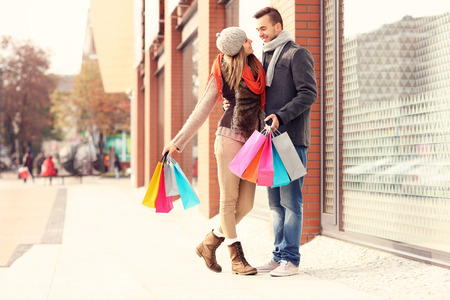 woman bag: A picture of a beautiful couple shopping together in the city Stock Photo