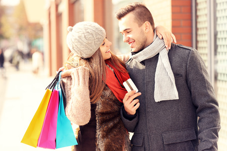 A picture of a beautiful couple shopping with a credit card in the city Stock Photo - 33745365