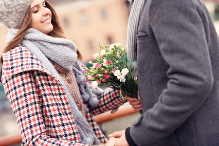 forgiving: A picture of a romantic couple on a date holding flowers Stock Photo