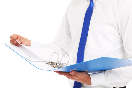 A midsection of a businessman holding documents over white background photo