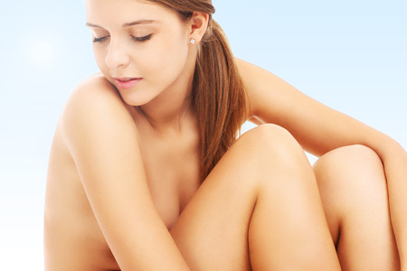 nude body: A picture of a sensual woman posing naked over bluish background Stock Photo