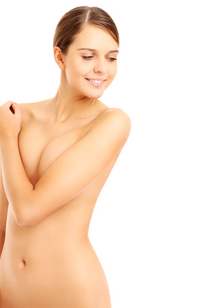 nude women: A picture of a beautiful nude woman posing over white background