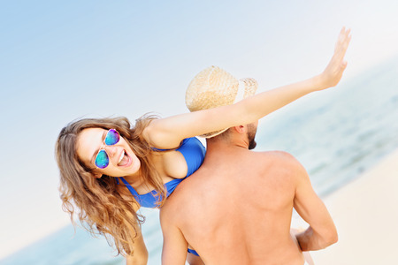 couple having fun: A picture of a young couple having fun at the beach in the summer
