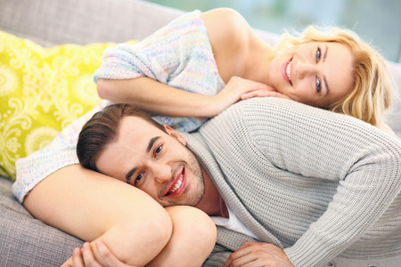 couple cuddling: A picture of a young couple relaxing at home
