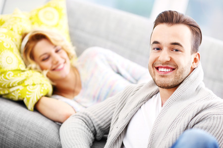 couple on couch: A picture of a young couple relaxing at home