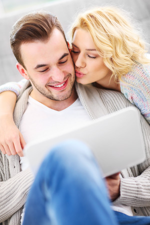 two sexy women: A picture of a romantic couple with laptop in living room
