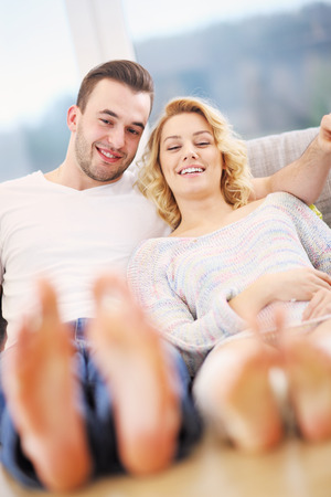 adult foot: A picture of a young couple relaxing at home