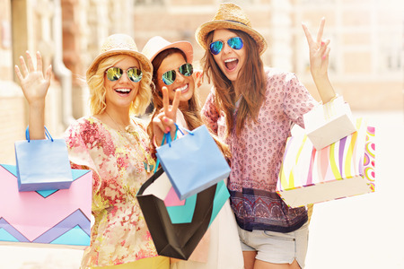 woman happy: A picture of a group of happy friends shopping in the city