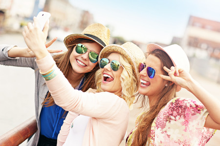 A picture of a group of friends taking selfie and having fun in the city