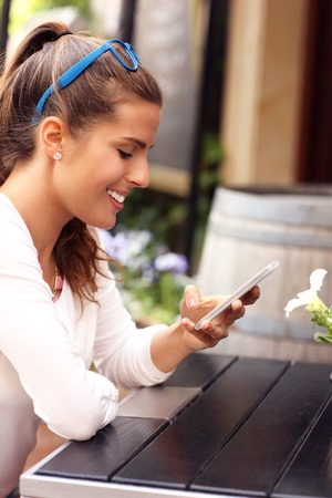 happy enjoy: A picture of a happy woman using smartphone in cafe Stock Photo