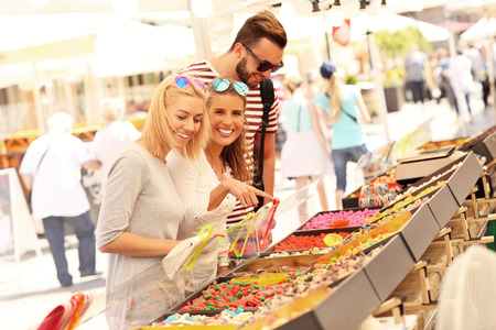 Jelly: A picture of a group of friends buying jelly sweets on market Stock Photo