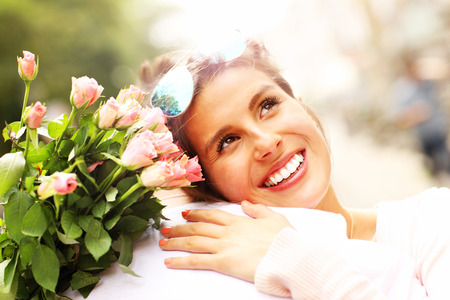forgiving: A picture of a pretty woman holding flowers and hugging a man