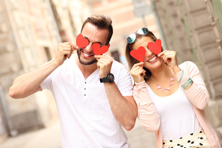 A picture of a happy couple covering eyes with hearts Stock Photo - 42863484