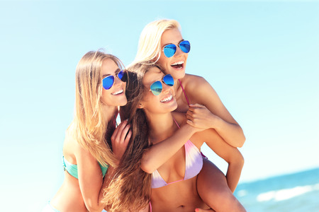 hot spring: A picture of a group of women having fun on the beach Stock Photo