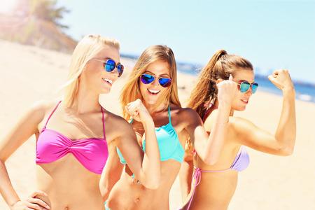 woman muscle:  group of sexy women having fun on beach Stock Photo
