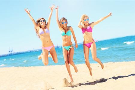 group of sexy women having fun on beach Stockfoto