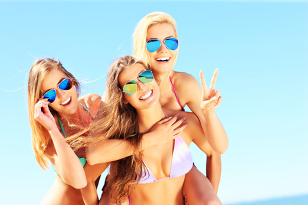 happy girls: A picture of a group of women having fun on the beach Stock Photo