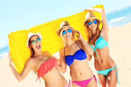 A picture of a group of women having fun on the beach Banco de Imagens