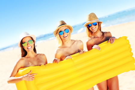 nude woman: A picture of a group of women having fun on the beach Stock Photo