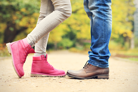 casual men: A picture of couples legs in the park in autumn