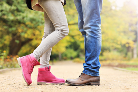 girl shoes: A picture of couples legs in the park in autumn