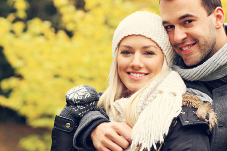 romantic hug: A picture of a young romantic couple in the park in autumn